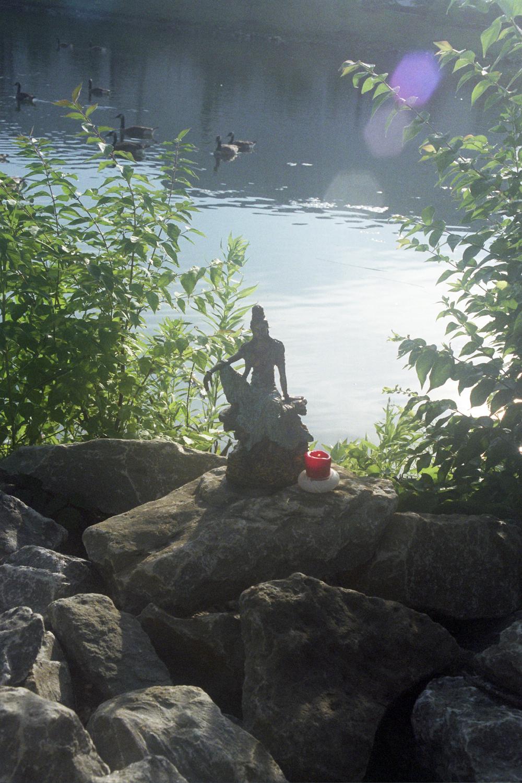 Quan Yin in a garden.
